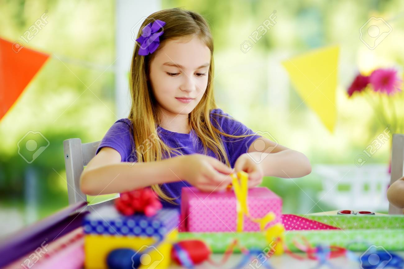 Cute Preteen Girl Wrapping Gifts In Colorful Paper Adorable Child Birthday Presents