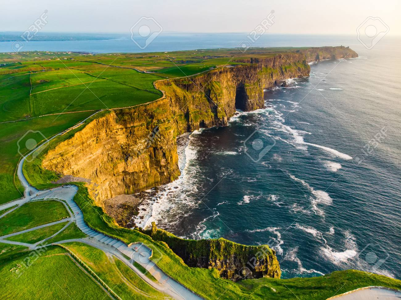 World famous Cliffs of Moher, one of the most popular tourist destinations in Ireland. Aerial view of widely known tourist attraction on Wild Atlantic Way in County Clare. - 103778707