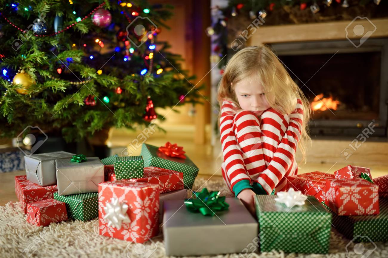 Cute Christmas Gifts For Girlfriend.Cute Little Girl Feeling Unhappy With Her Christmas Gifts Child