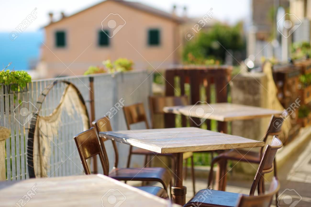 Beautifully decorated small outdoor restaurant tables in Riomaggiore village, Cinque Terre, Liguria, Italy - 125133073
