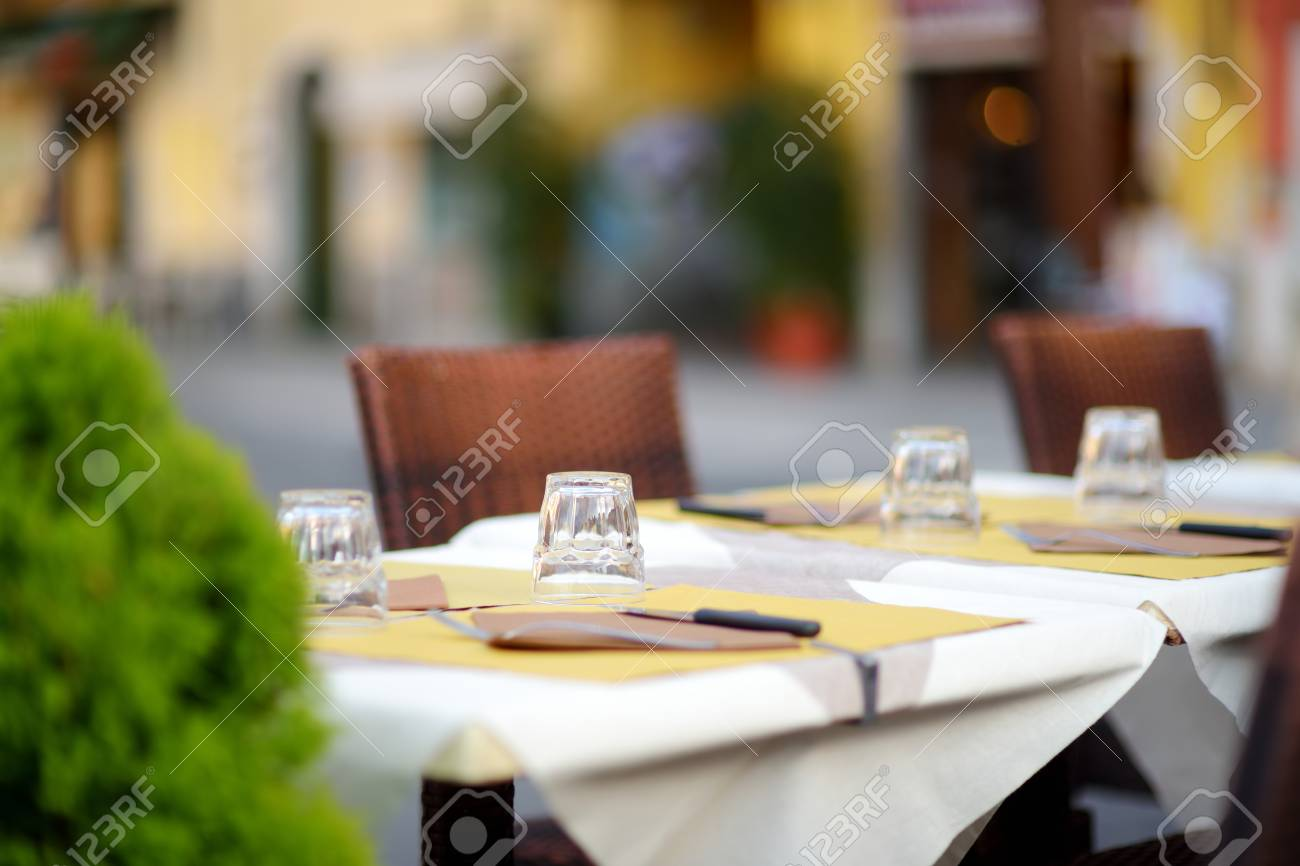 Beautifully Decorated Small Outdoor Restaurant Tables In The Stock Photo Picture And Royalty Free Image Image 125133582