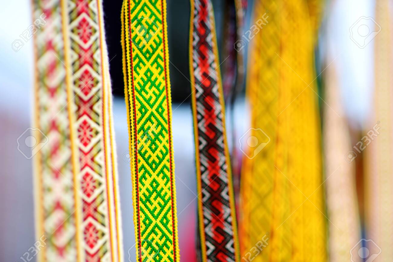 Details of a traditional colorful Lithuanian weave. Woven belts as a part of national Lithuanian costume sold on traditional Easter fair in Vilnius, Lithuania. - 135493294