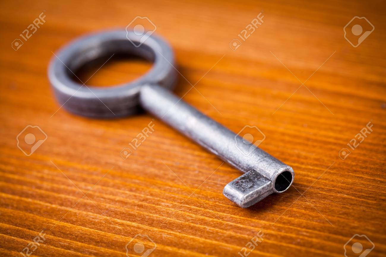Old key on wooden table, close up photo Stock Photo - 17948256