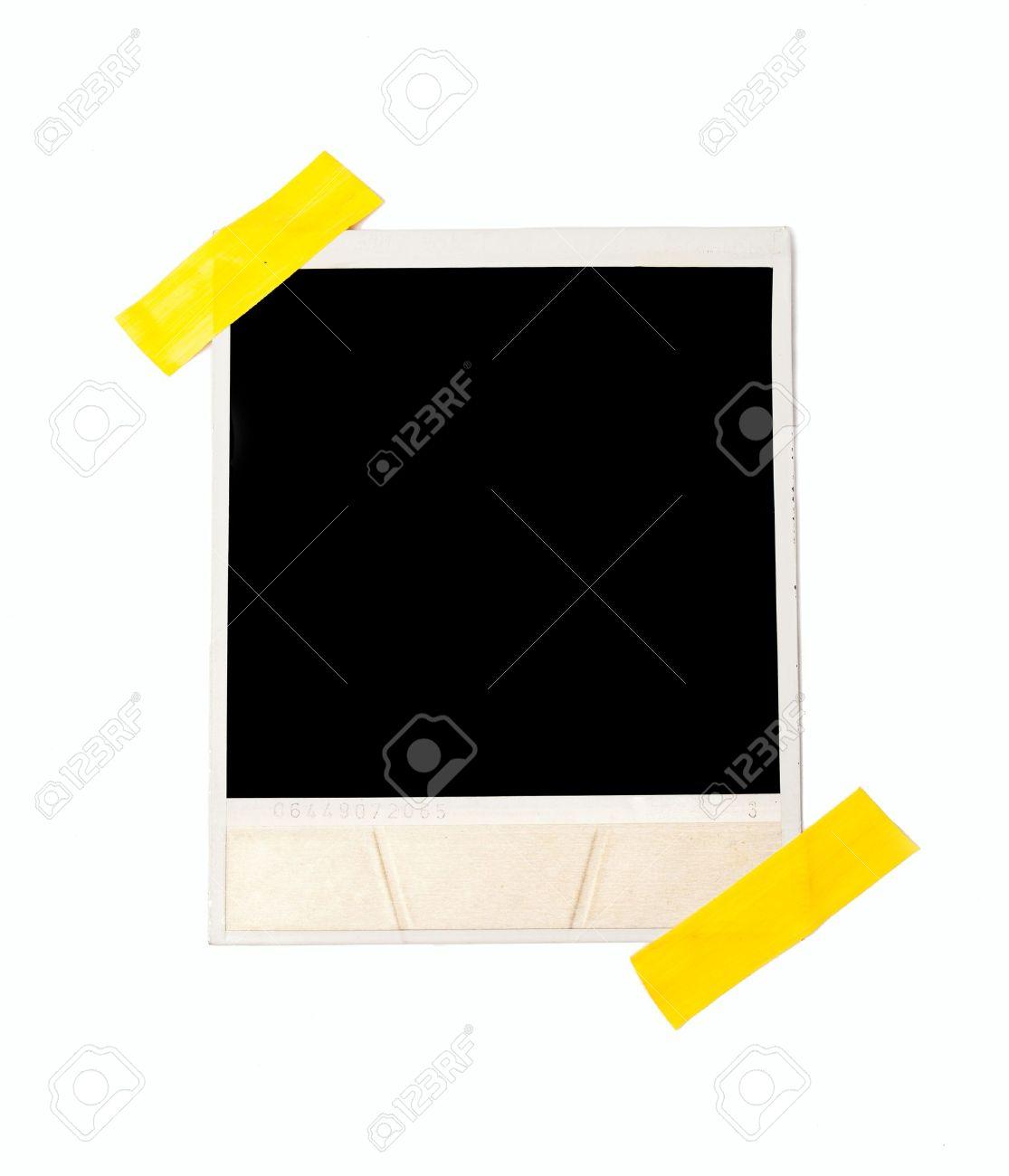 Taped polaroid style photo frame, isolated on white Stock Photo - 19494935