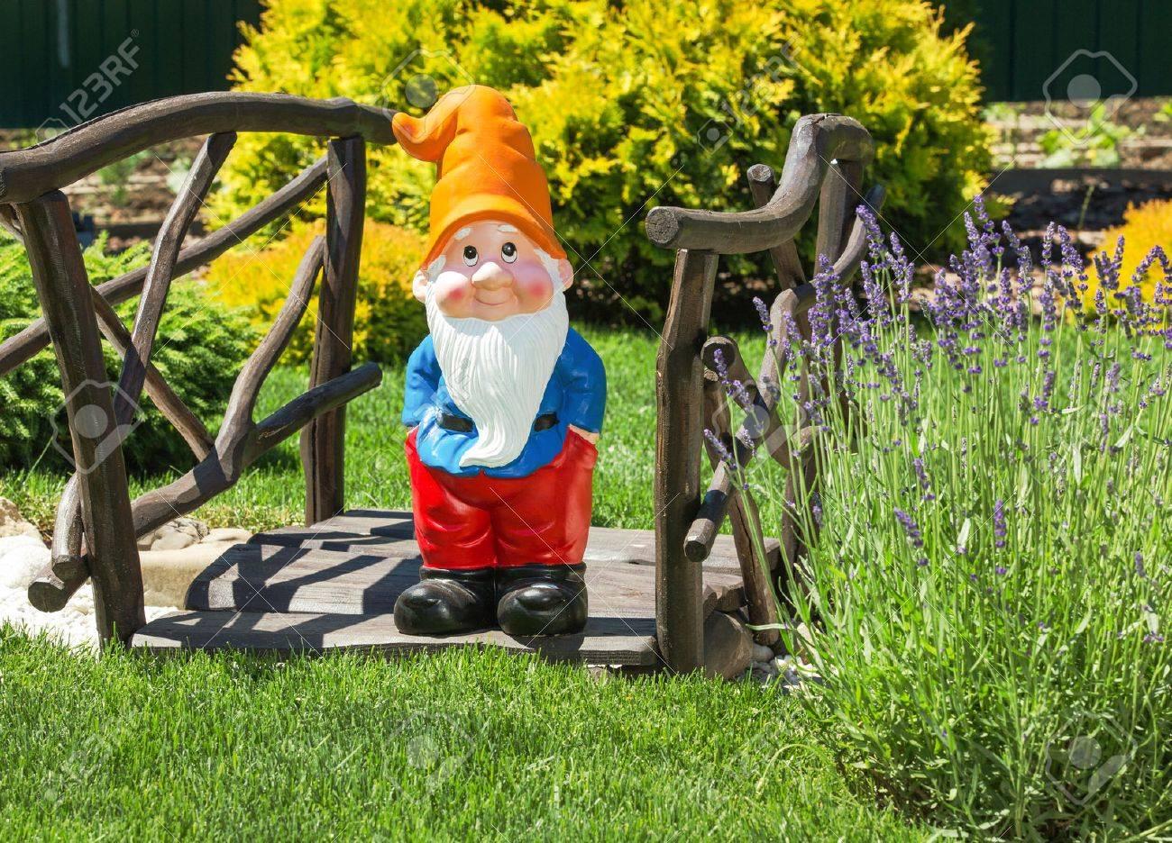 Wooden Decorative Bridge With Garden Dwarf In Home Garden. Stock ...