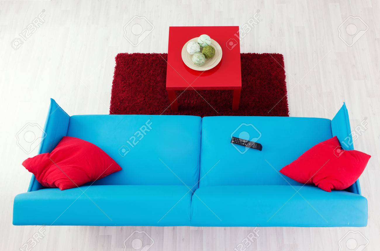 Groovy Blue Sofa With Red Pillows And Red Coffee Table Top View Interior Design Ideas Oxytryabchikinfo