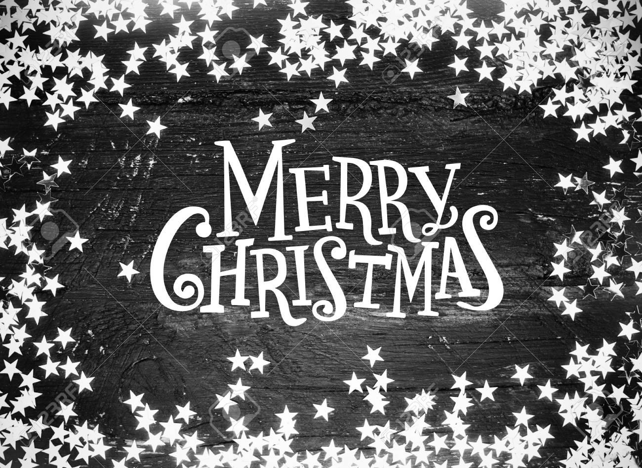 Glitter étoiles Sur Bois Grunge Avec Le Texte Joyeux Noël Noir Et Blanc