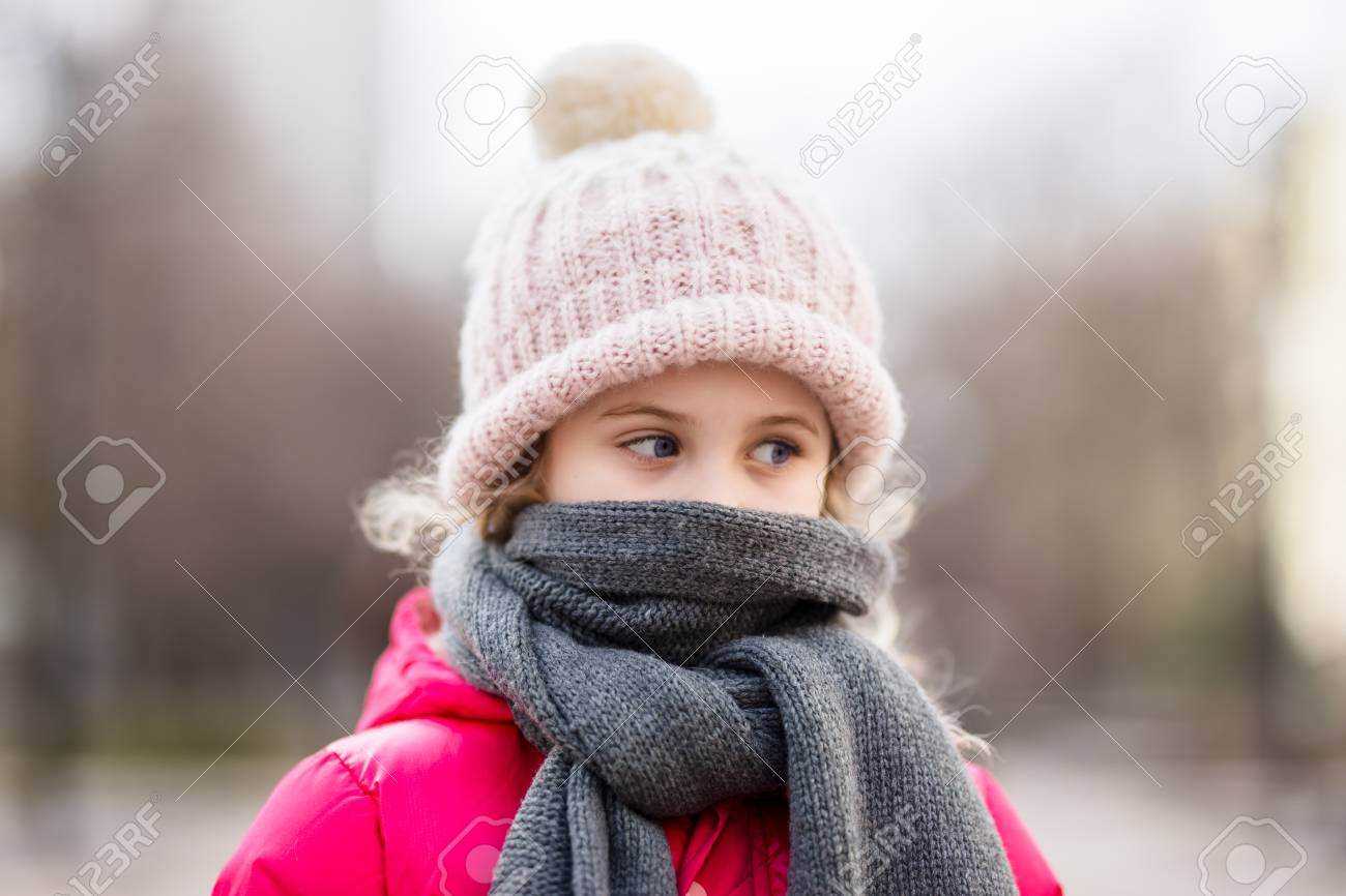 277c3ea1b Closeup Portrait Of Cute Baby Girl Wearing Knitted Hat And Winter ...