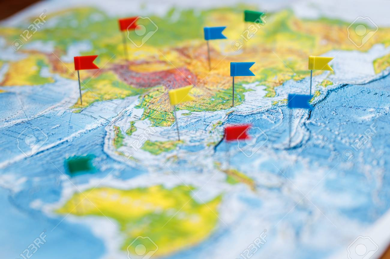 Travel concept with flag pushpins and world map stock photo picture stock photo travel concept with flag pushpins and world map gumiabroncs Images