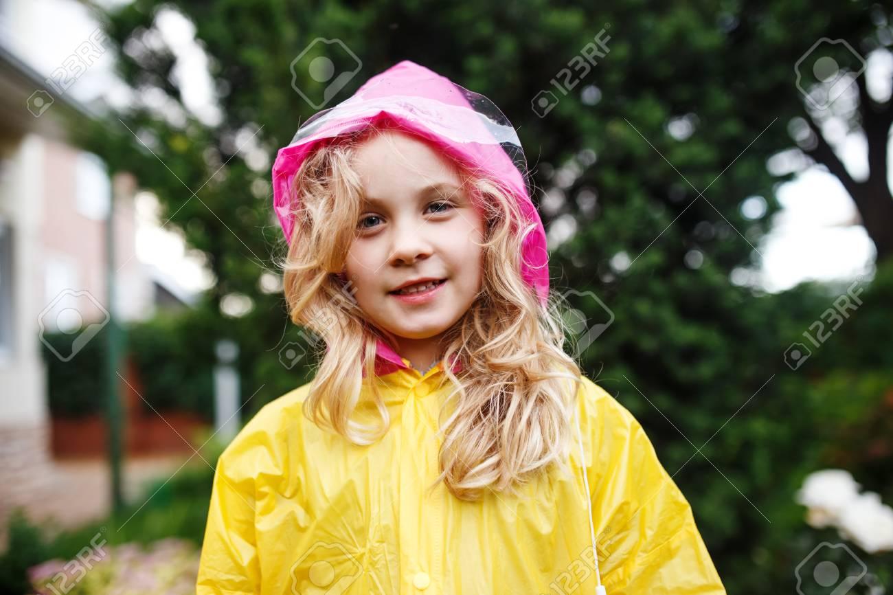 73c7bc0d0 Happy Little Child Girl In Yellow Raincoat. Stock Photo