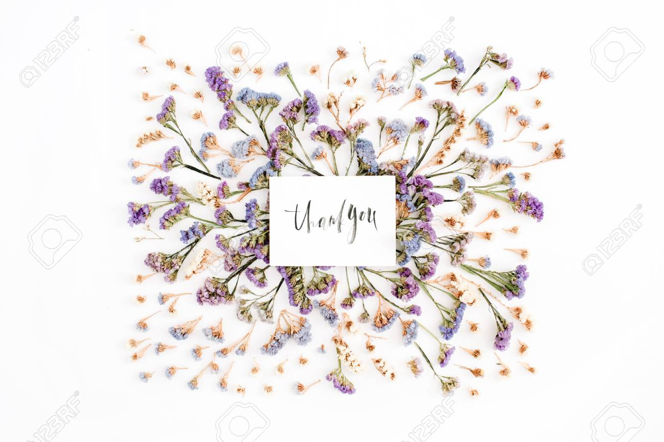 Words Thank You Written In Calligraphic Style On Paper With