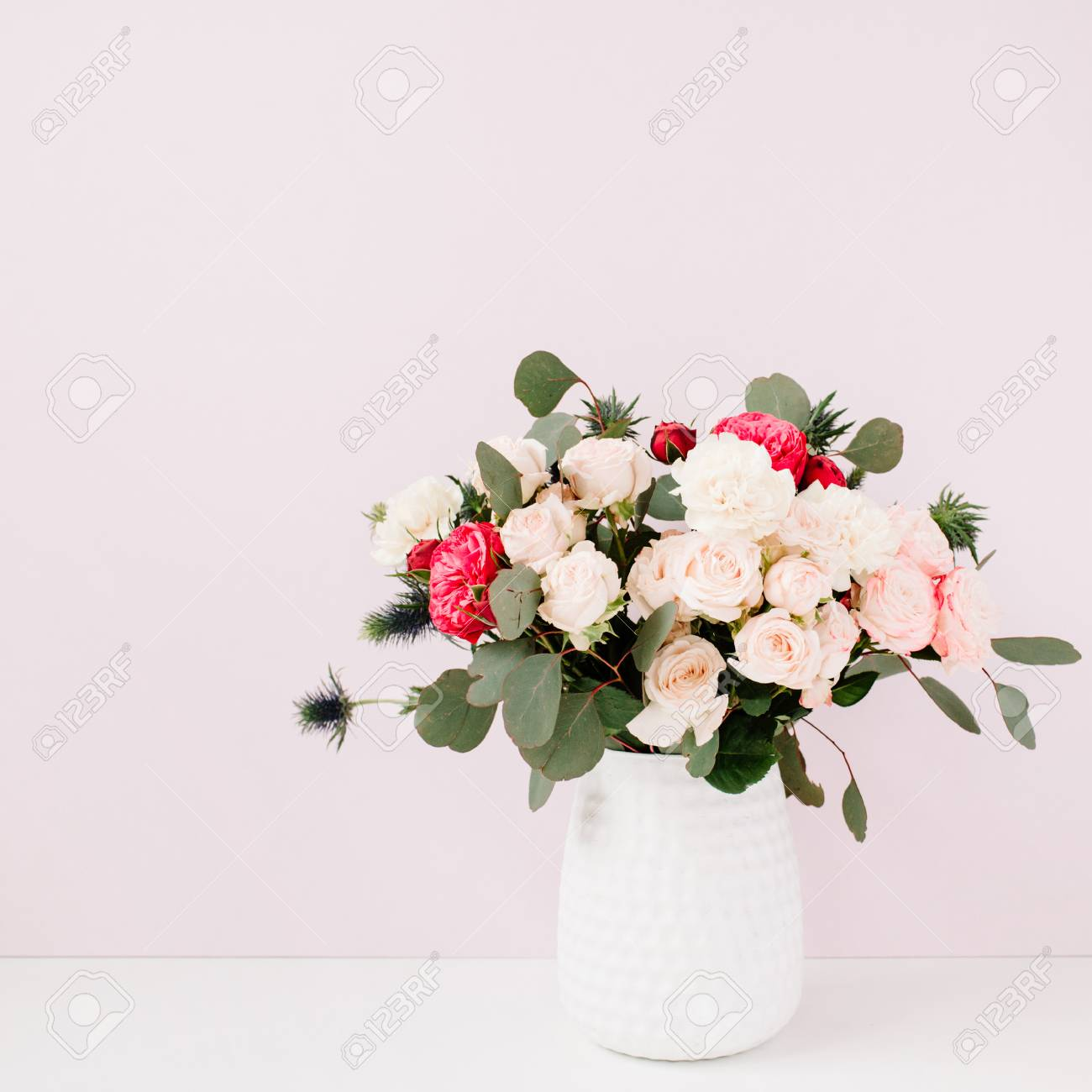 Beautiful Flowers Bouquet In Flowerpot In Front Of Pale Pastel ...