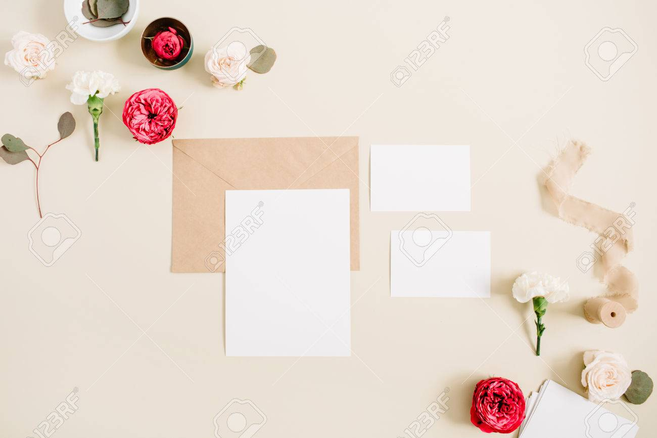 Wedding invitation cards craft envelope pink and red rose flower stock photo wedding invitation cards craft envelope pink and red rose flower buds and white carnation on pale pastel beige background stopboris Choice Image