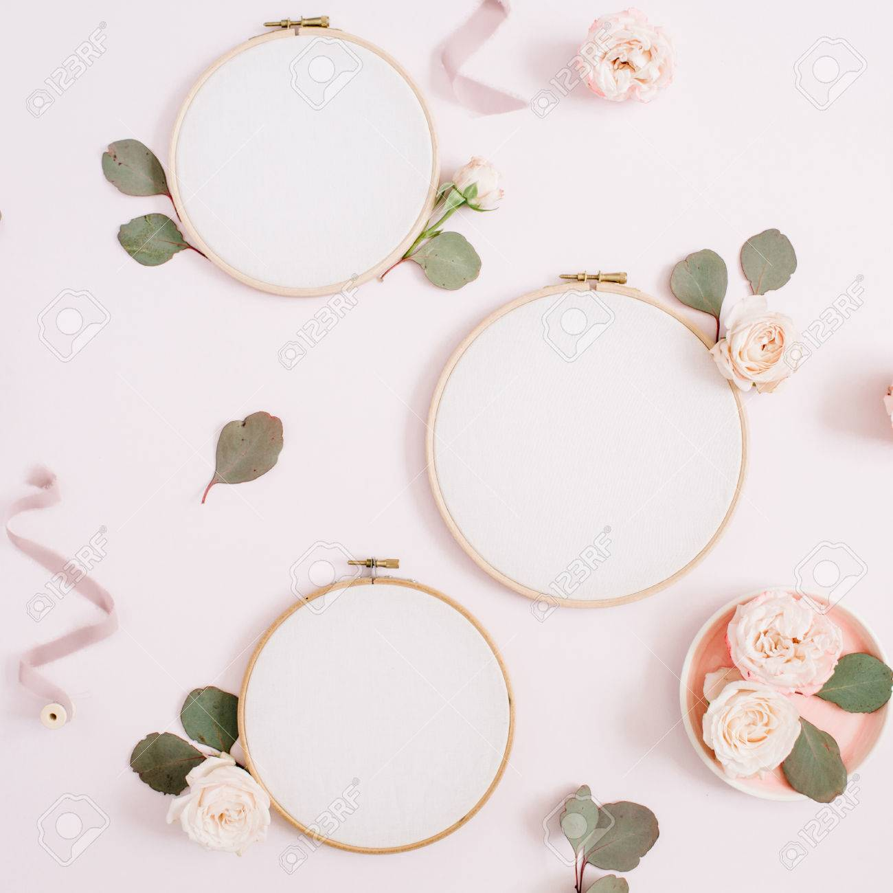 embroidery frames with beige rose flower buds and eucalyptus on pale pastel pink background flat - Embroidery Frames