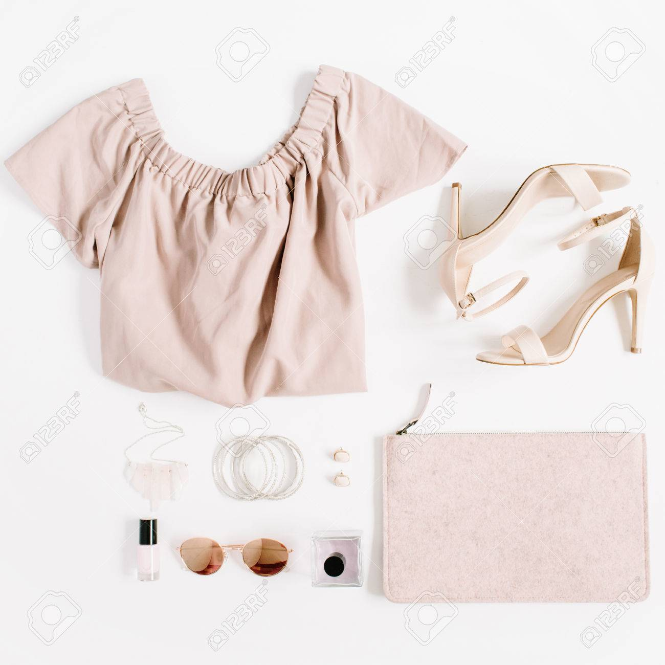 67a0c0992e47 Stock Photo - Woman fashion clothes and accessories collage on white  background. Flat lay, top view feminine background.