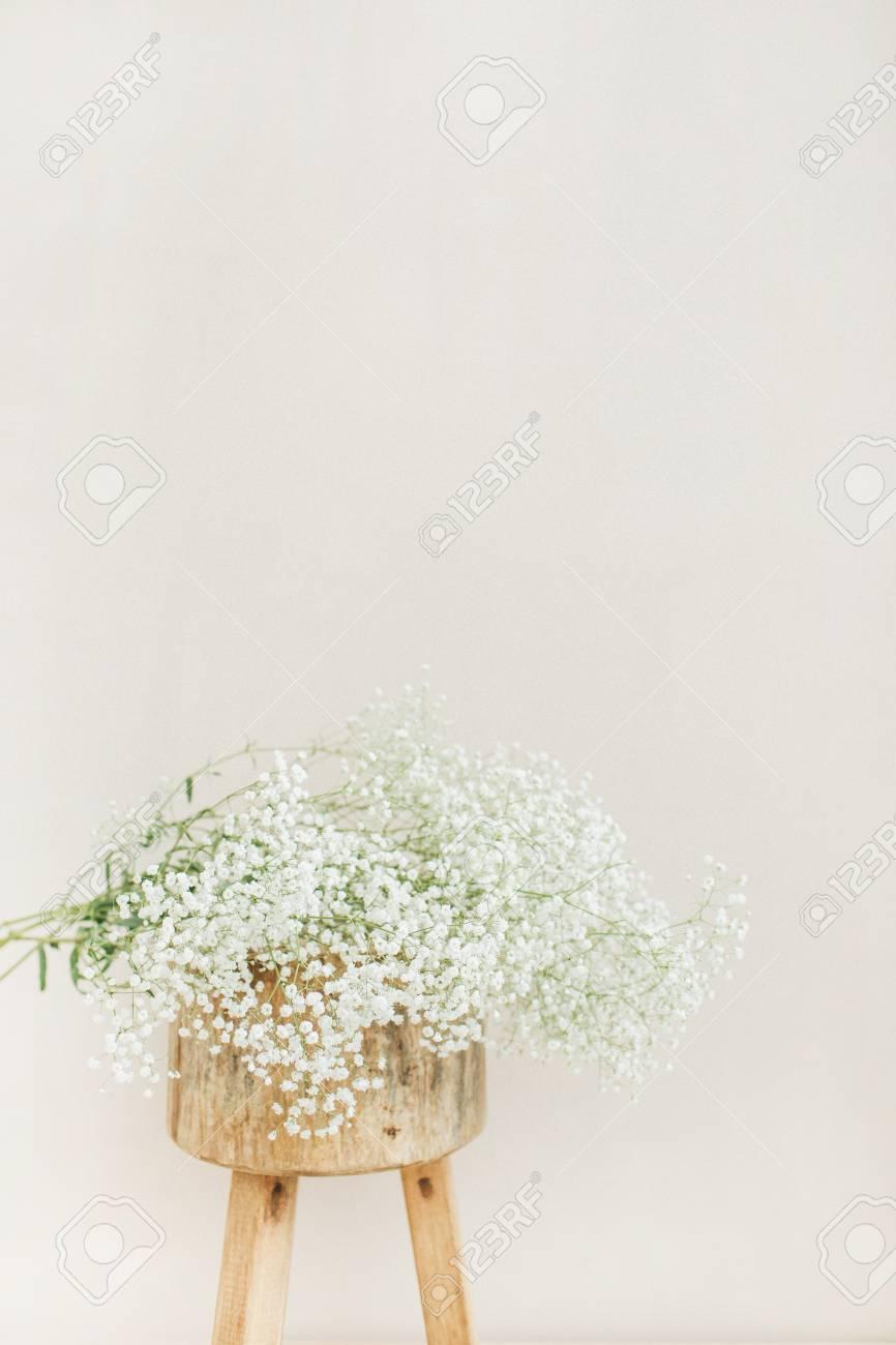 White gypsophila flowers bouquet on wooden backless stool at stock stock photo white gypsophila flowers bouquet on wooden backless stool at pale pastel beige background minimal festive holiday concept mightylinksfo