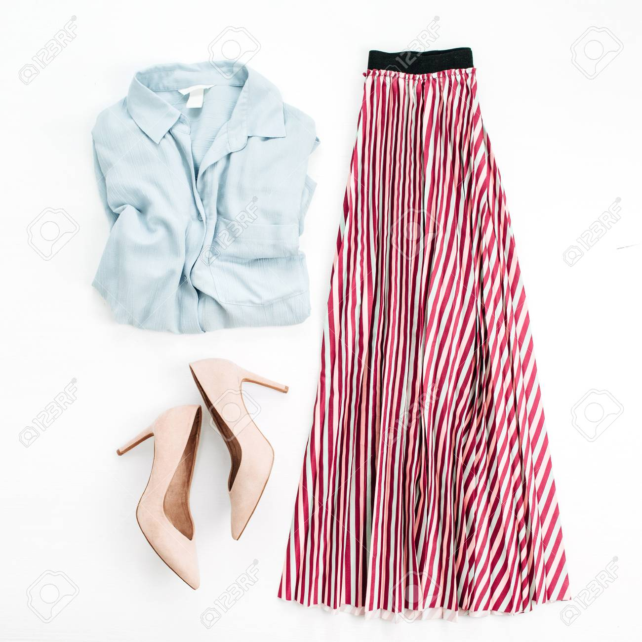 Woman clothes on white background. Jeans shirt, skirt, high heel shoes. Flat lay, top view. Minimal fashion collage.