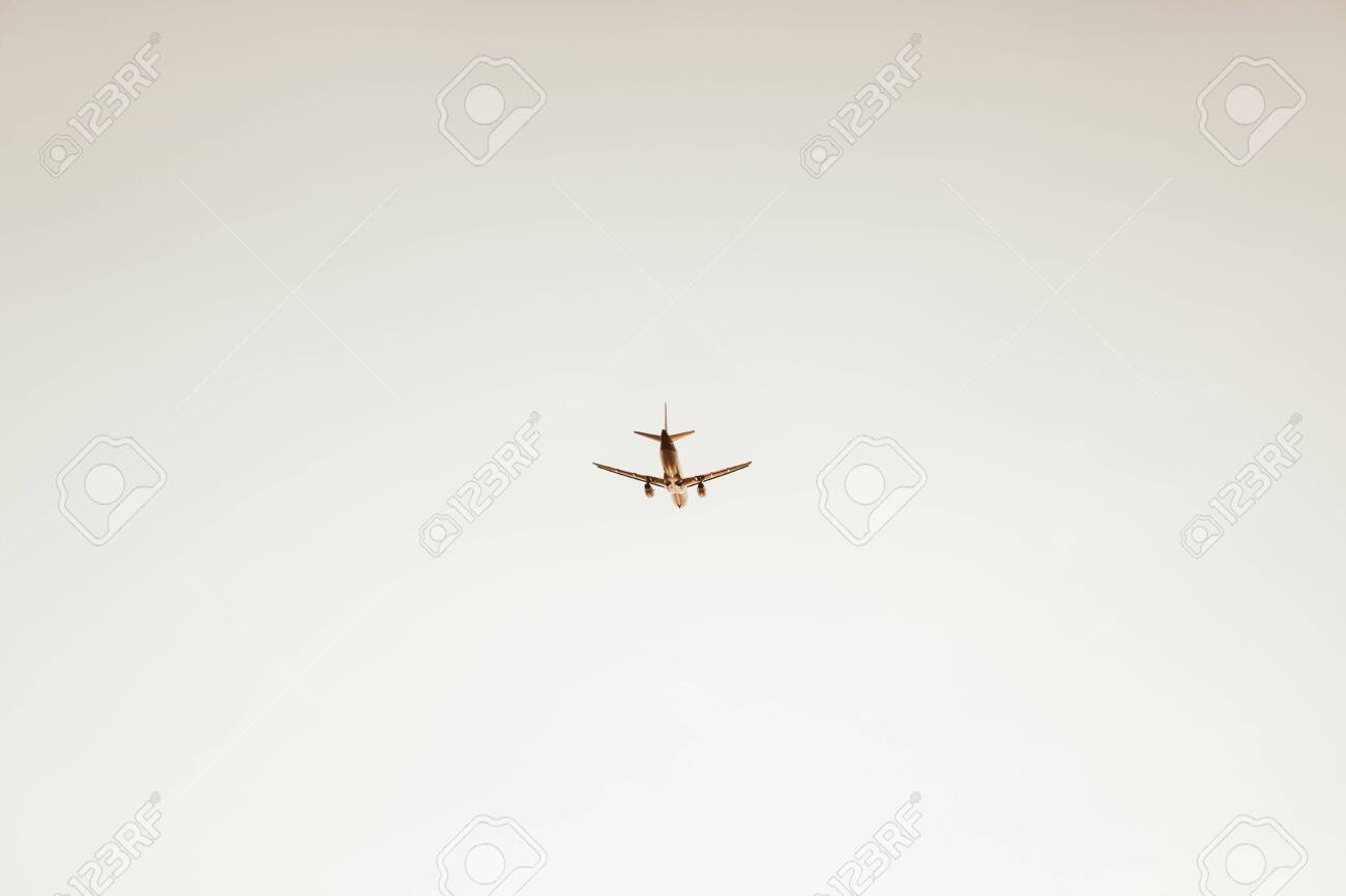 Airplane flying in the sky at sunset  Travel, vacation and holiday