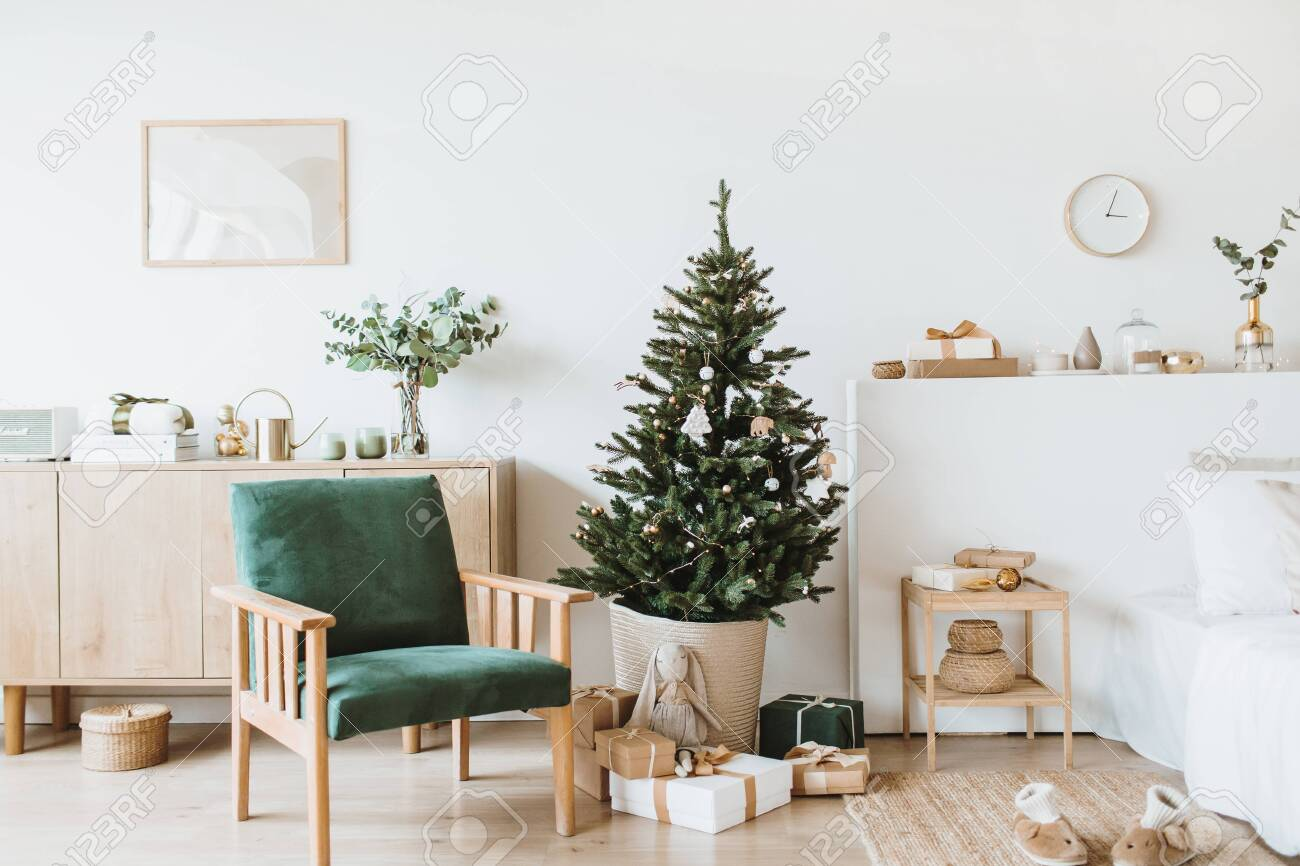 Modern interior design living room with Christmas / New Year decorations, toys, gifts, fir tree. Winter holidays composition. - 131471341