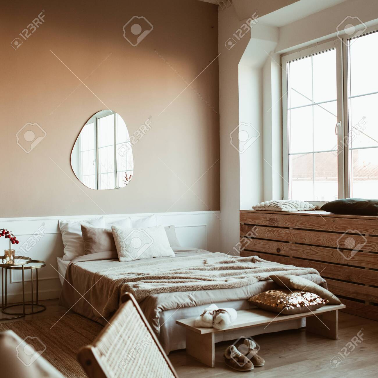 Picture of: Stylish Beige Color Bedroom With Bed Linen Pillows Mirror Stock Photo Picture And Royalty Free Image Image 143860653