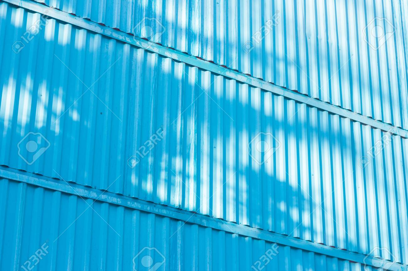 The blue figure of corrugated texture. Concept: reliable, abstract, creative, art, fence. - 74993131