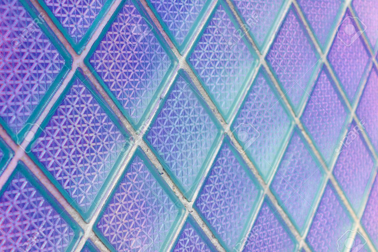 Decorative and glossy glass block window as a texture or for background. The wall. Geometric background. - 74993135