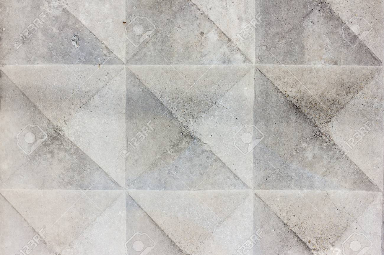 Background texture of old gray concrete fence with square pattern. Geometric pattern - 74993115