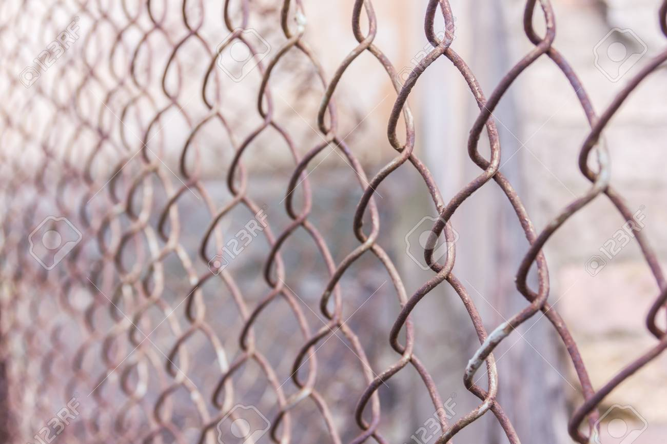 Rusty Steel Chain Link Or Wire Mesh As Boundary Wall There Is Wiring Behind Still Concrete Block
