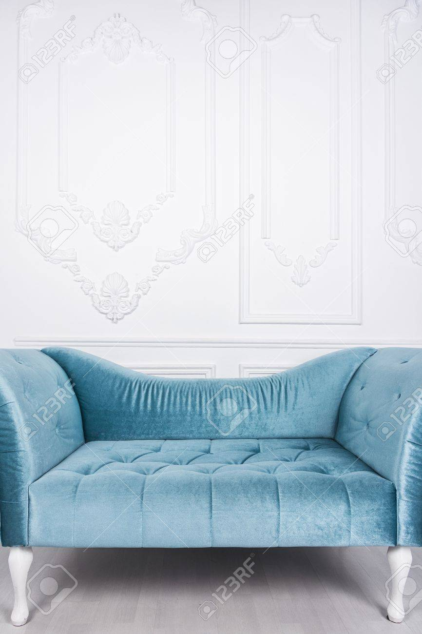 Blue sofa in white interior and gray floor - 76570645