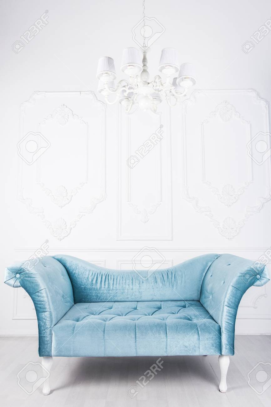 Blue sofa in white interior and gray floor - 76051555