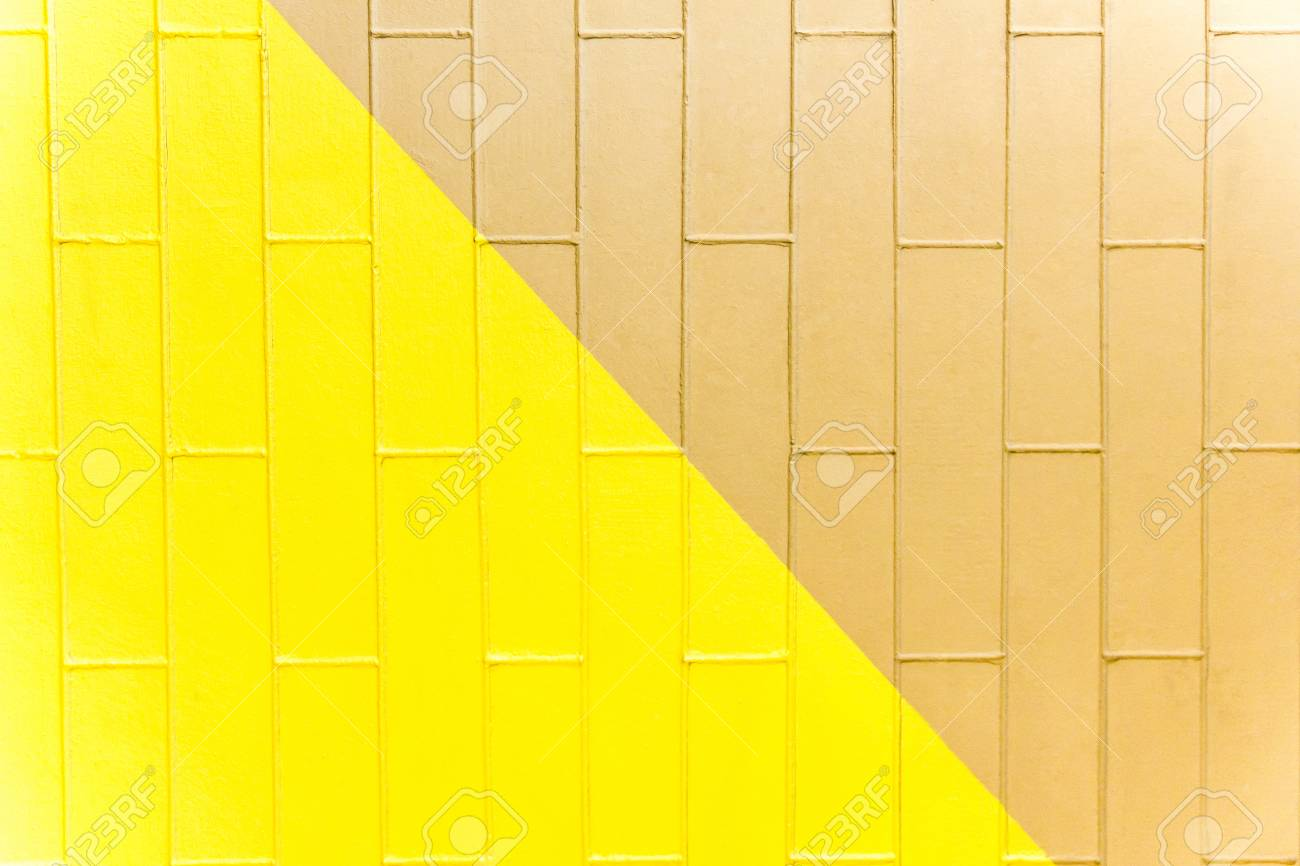 Yellow and brown brick wall texture. Two-color abstract background - 75806884