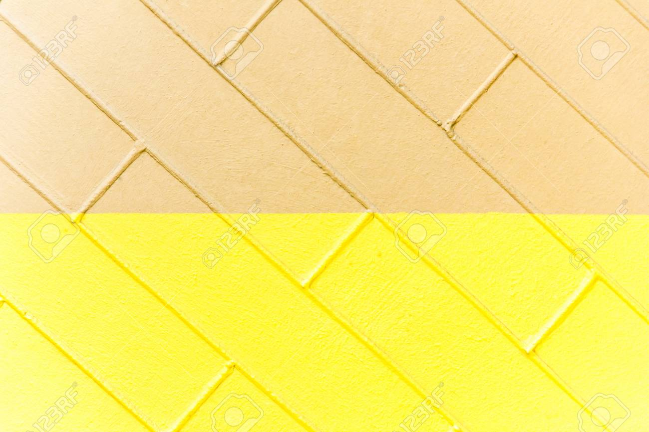 Yellow and brown brick wall texture. Two-color abstract background - 75979029