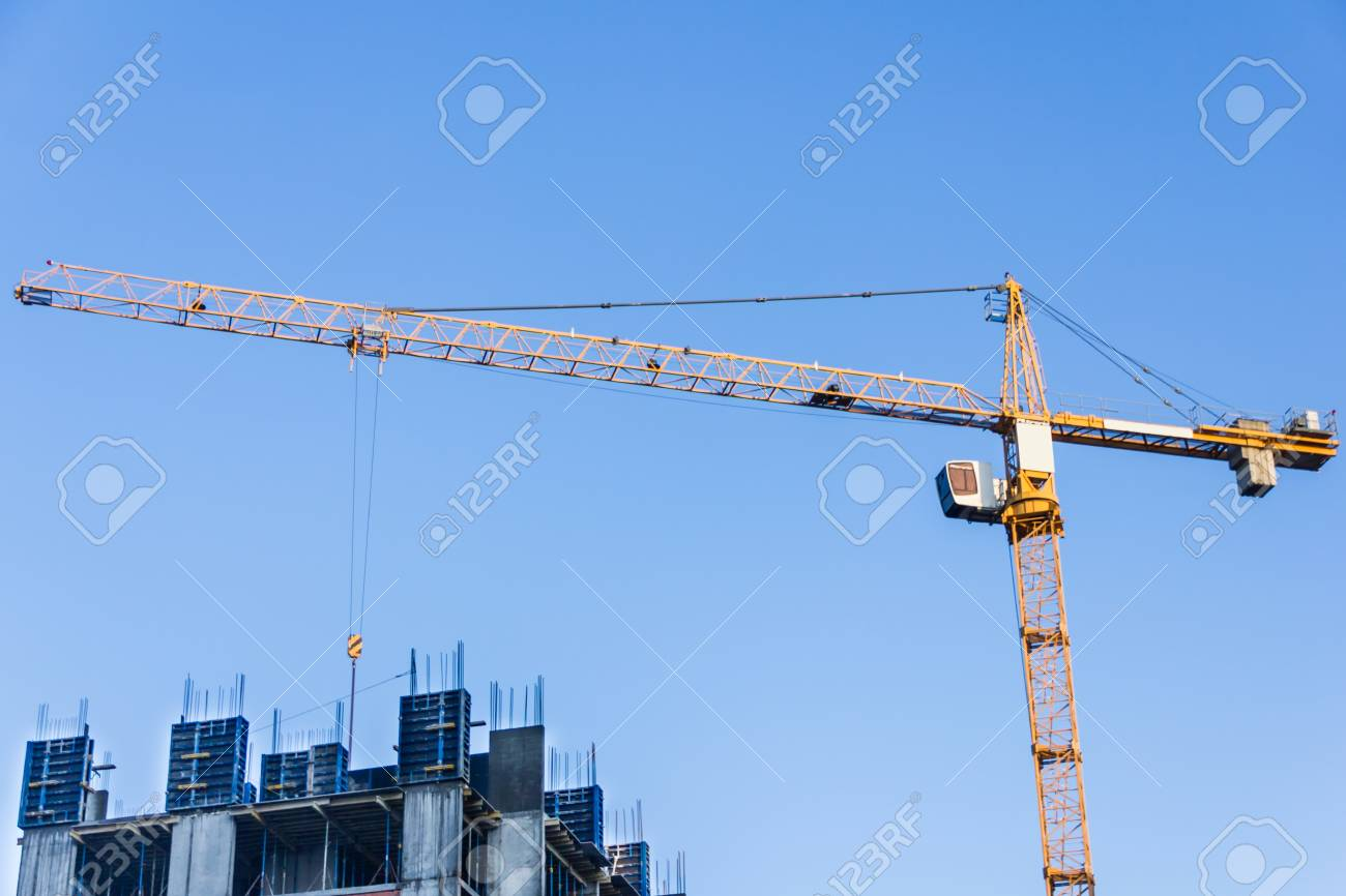 A new building is being constructed with use of tower crane. - 75885541