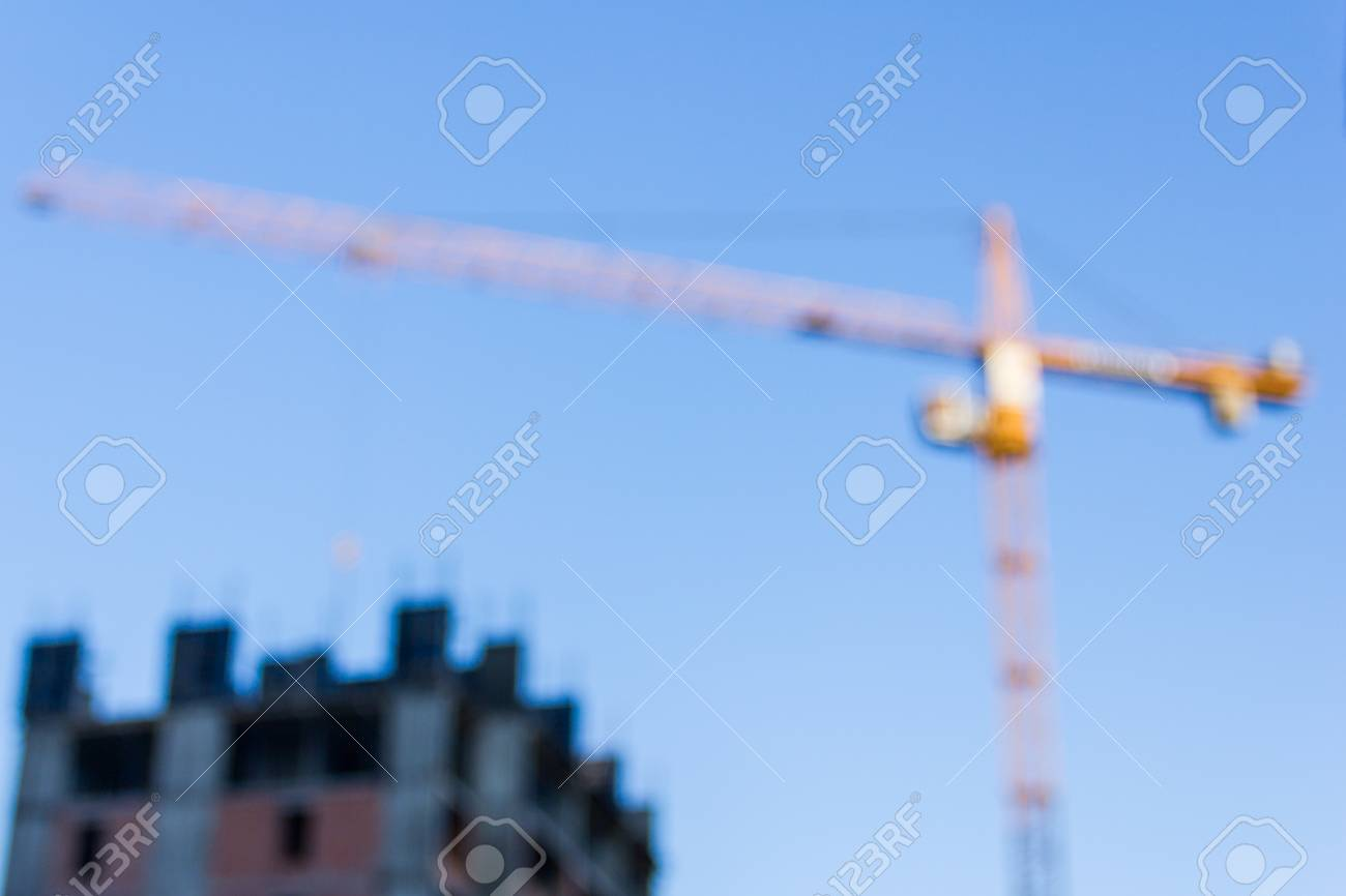 A new building is being constructed with use of tower crane. - 75969036