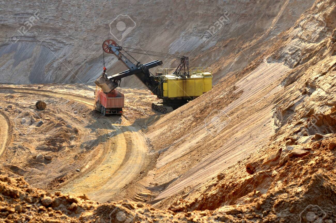 Excavator Loading Sand To The Heavy Dump Truck At Opencast Biggest Stock Photo Picture And Royalty Free Image Image 138907786