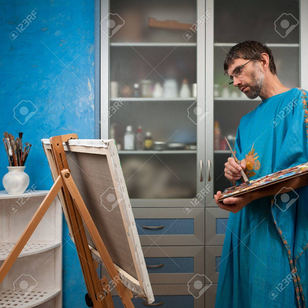 an artist paints a picture in the studio on canvas Stock Photo - 14719034