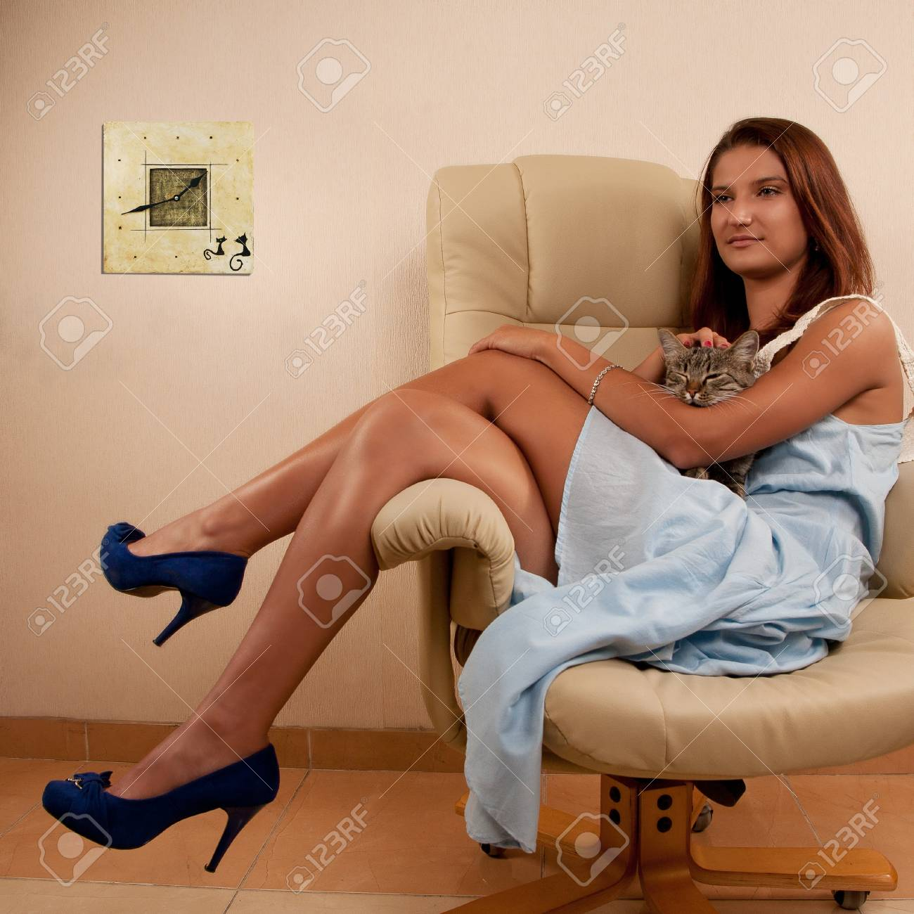 young girl sitting in chair with cat Stock Photo - 15170789