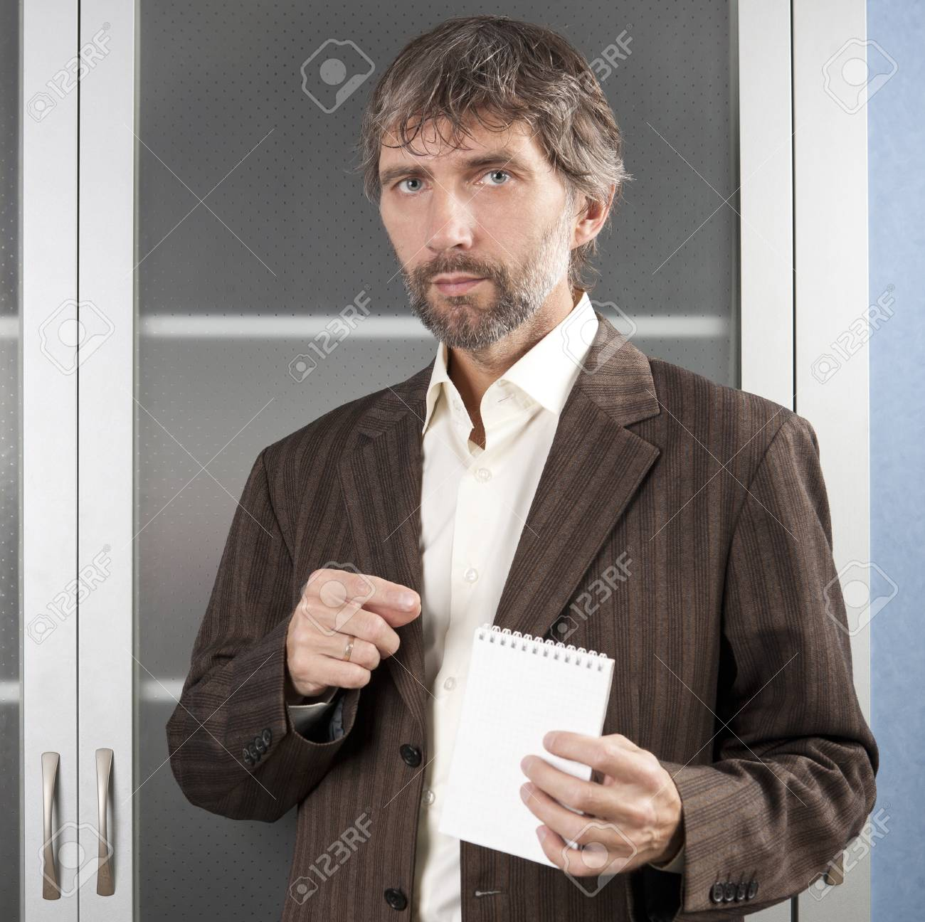 man in business suit shows blank Notepad Stock Photo - 16469820