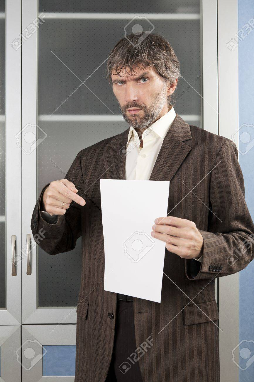 angry man in business suit shows blanc sheet of paper Stock Photo - 17395018