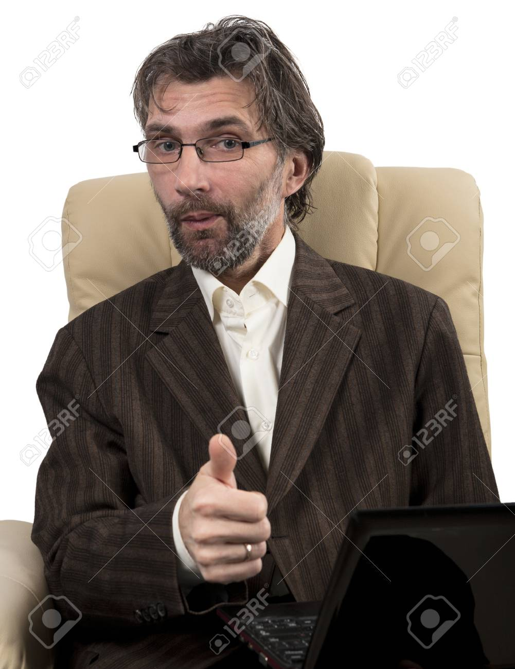 happy businessman in suit sitting in chair with notebook isolated white Stock Photo - 17395043