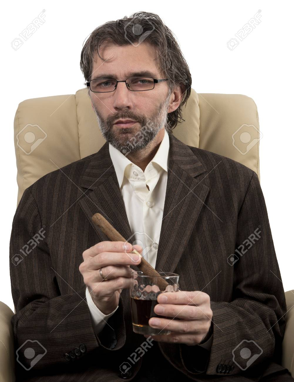 businessman in suit sitting in chair with cigar isolated white Stock Photo - 17395049
