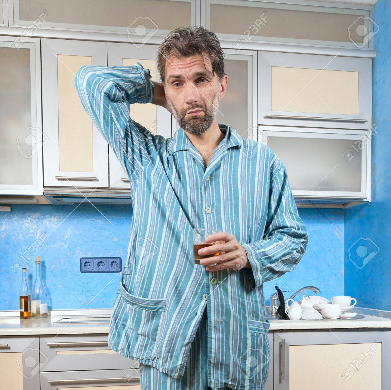 mature drunk man standing in pajamas with glass Stock Photo - 18323568