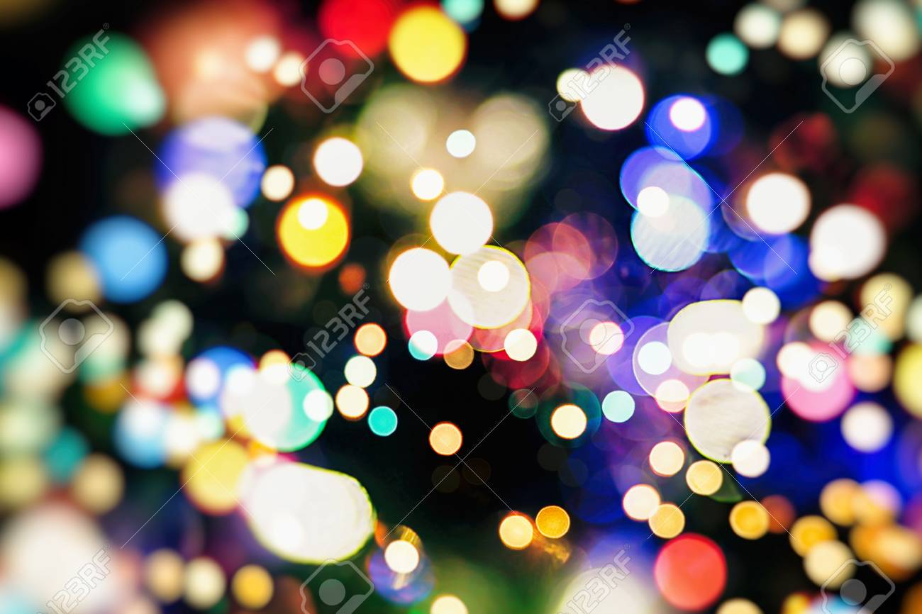 Superb Abstract Festive Background. Glitter Vintage Lights Background With Lights  Defocused. Christmas And New Year