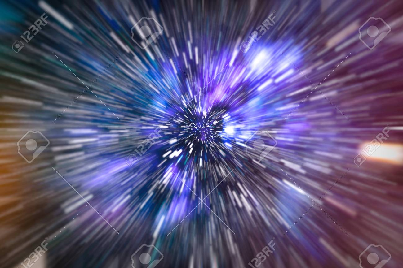 Abstract of warp or hyperspace motion in blue star trail. - 99414875