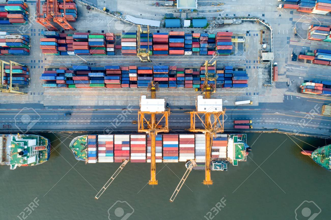 containers yard in port congestion with ship vessels are loading