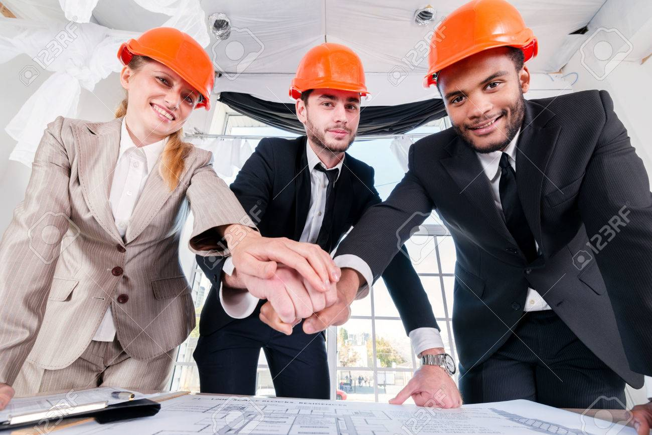 Successful Architects architects laid hands on hands. three businessmеn architect