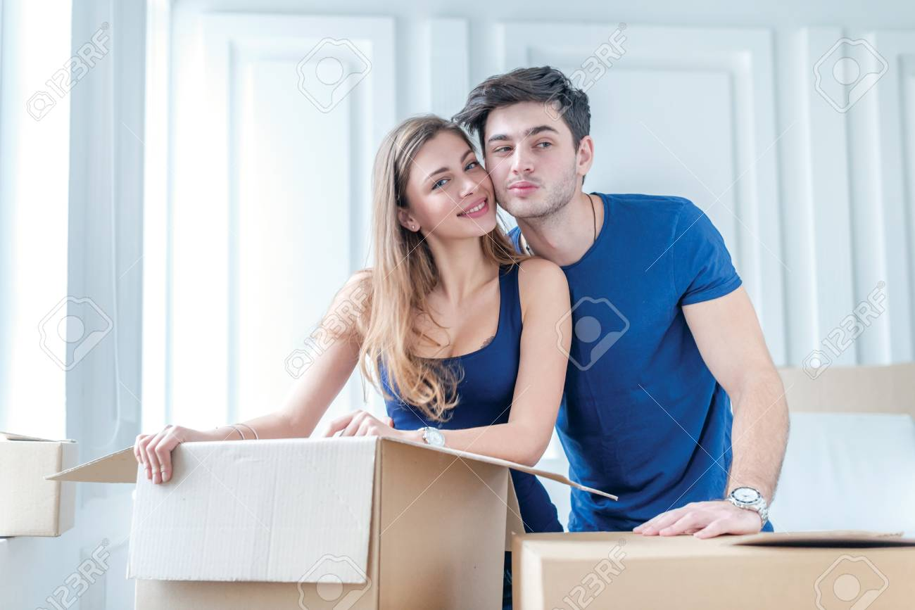 Moving Repairs New Apartment A Loving Couple Holding Box In