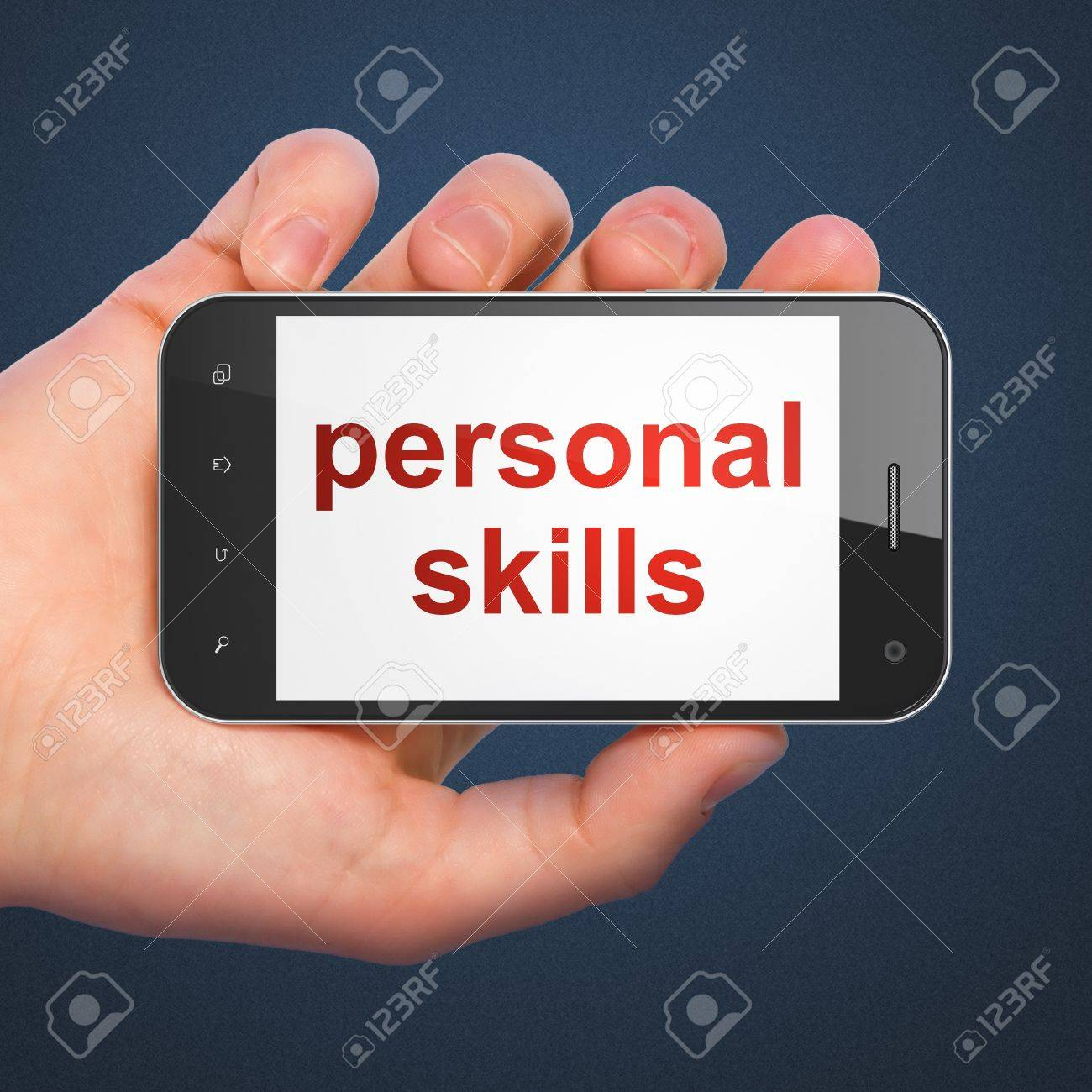 hand holding smartphone word personal skills on display hand holding smartphone word personal skills on display generic mobile smart phone in hand