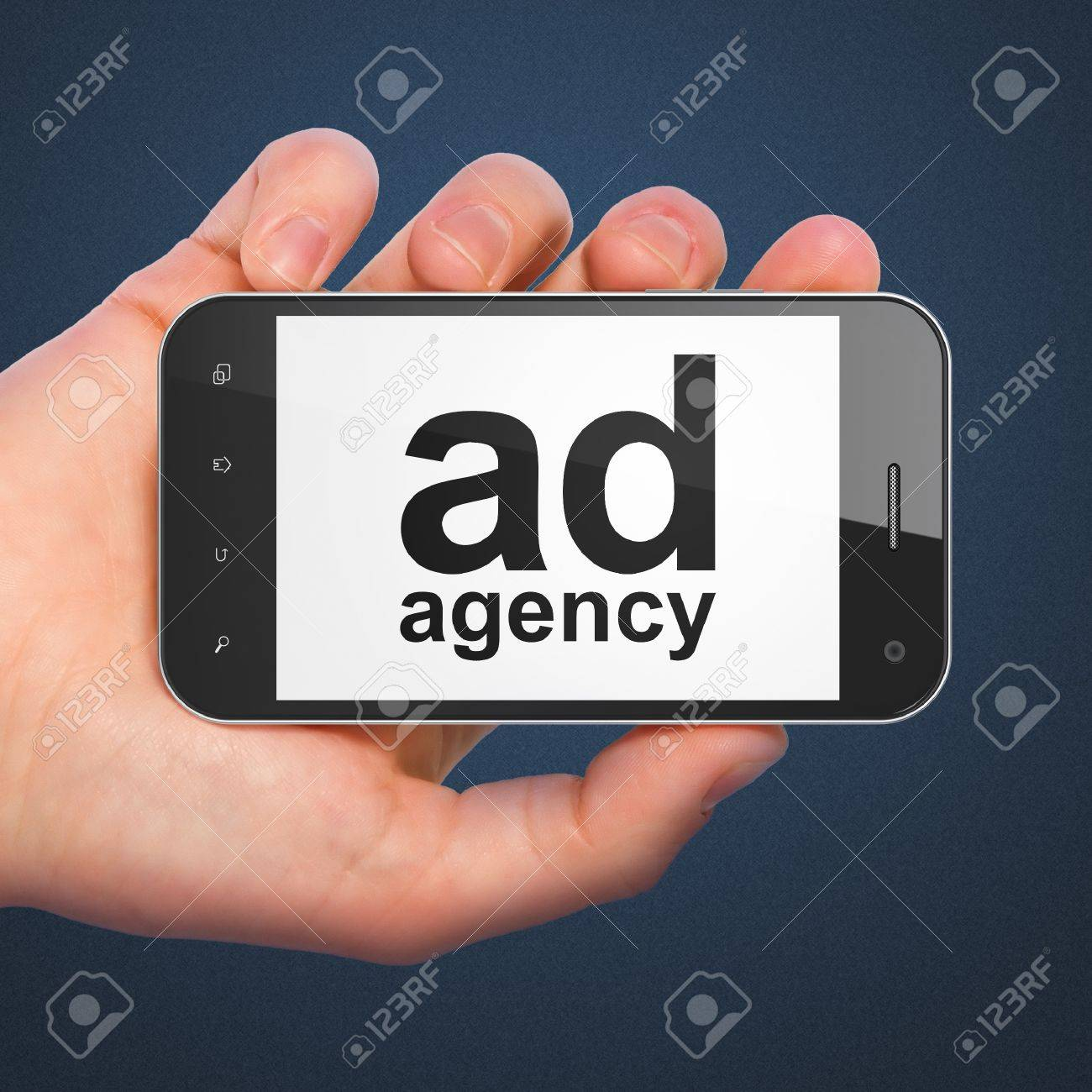 marketing concept hand holding smartphone with word ad agency