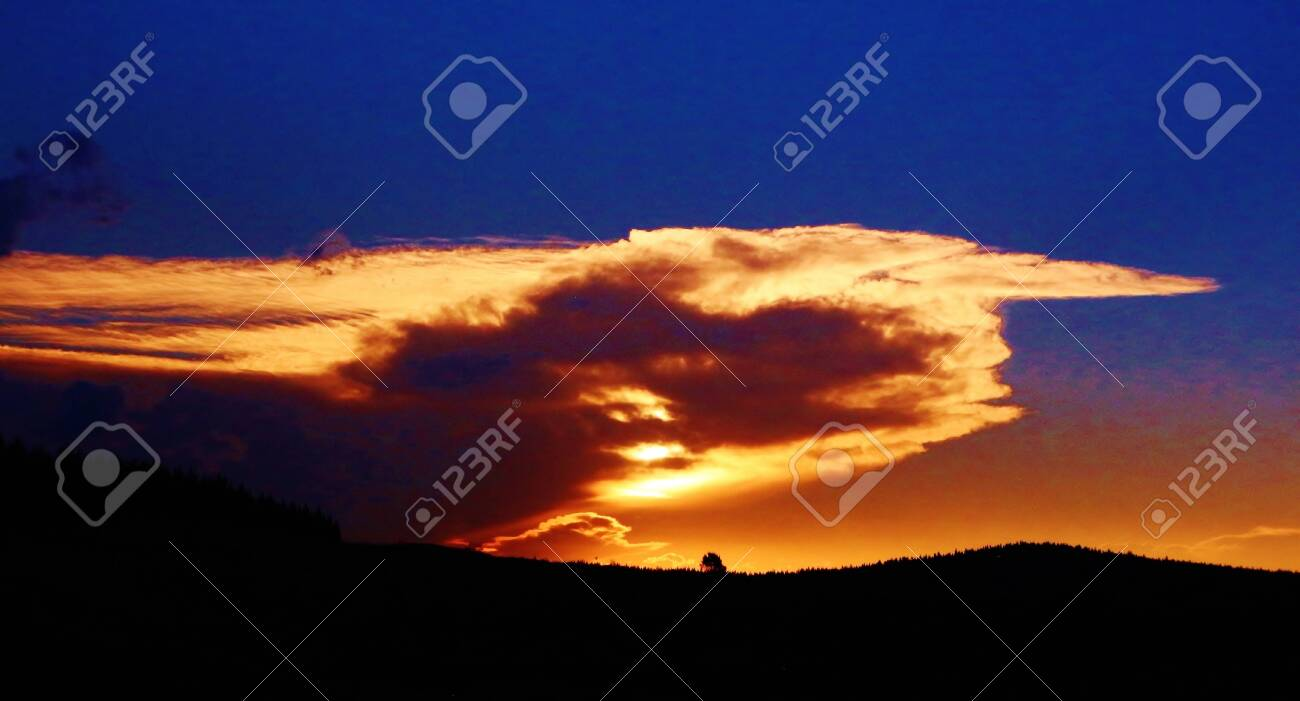 Dramatic sky over hills and a tree. Photo taken at God's Window (Mpumalanga) in South Africa. - 143249234